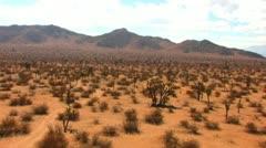 Stock Video Footage of Mojave Desert Plain and Rocky Ridge 2