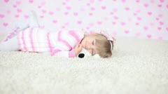 Happy baby on the carpet with teddy bear Stock Footage