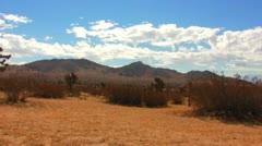 Stock Video Footage of Mojave Desert Plain and Rocky Ridge 6