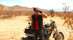 Motorcycle Gang Cell Phone Call In Desert Stock Footage