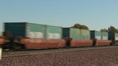 Railroad, fast container train in the desert, MS Stock Footage