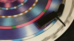 Psychodelic LP spinning on a turntable - stock footage