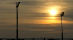 Sunset between Floodlights at Sports Field Stock Footage