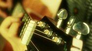 Playing guitar,strum,golden sunlight. Stock Footage