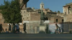 Tourists look at statue of Caesar in Rome Stock Footage