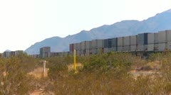 Railroad, fast container train in the desert, eastbound, LS Stock Footage