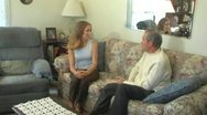 Stock Video Footage of Older Man Young Woman Talking on Couch