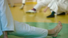 Coach at the gym teaches children Martial Art Stock Footage