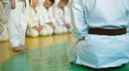 Martial arts instructor training children Stock Footage