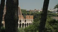 Ancient roman ruins and the Colosseum in Rome, Italy Stock Footage