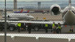 Aircraft, Gulfstream IV parked with BAE 125-800 taxi, busy scene, LAS Stock Footage