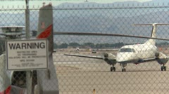Aicraft, commuter plane taxi with jet takeoff in BG, LS Stock Footage
