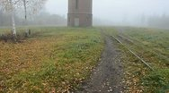 Stock Video Footage of old tower in the derelict railway station and mist