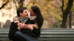 woman embracing man in park - stock footage