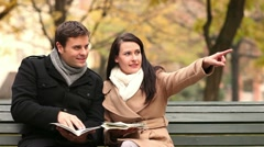 Happy couple reading city map Stock Footage