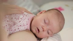 Baby sleep on mothers hahds after nursing Stock Footage