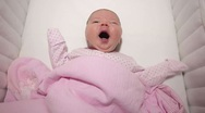 Stock Video Footage of Baby laying in the crib and yawning