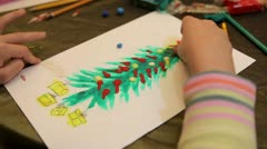 Childs hand draw christmas fir-tree from plasticine. Stock Footage