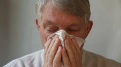 Man blows his nose Stock Footage