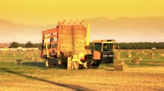 hay bale machine loader on farm - stock footage