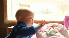 Brother tries to comfort baby sister Stock Footage