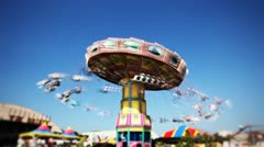 carnival swing ride at midway (time-lapse) - stock footage