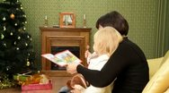 Mom reads a book her daughter Stock Footage