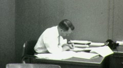 Man Signs ENDLESS PAPERWORK Office Worker Desk 1960 Vintage Film Home Movie 1565 Stock Footage