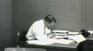 Stock Video Footage of ENDLESS PAPERWORK Office Worker at Desk 1960 Vintage Film Home Movie 1565