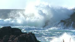 Waves crashing on rocky shore MS Stock Footage
