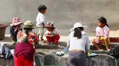 AMBATO, ECUADOR - 22 NOVEMBER 2011: Poor people washing their clothing on the Stock Footage