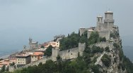 Stock Video Footage of HD Aerial View of San Marino, Guaita Tower, Morning Fog, Castle, Old Town Hall