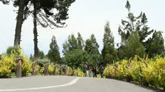 AMBATO, ECUADOR - CIRCA DECEMBER 2011: Unidentified people passing by in La Stock Footage