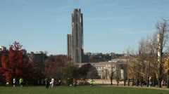 American football play in front of University of Pittsburgh Stock Footage