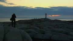 Photographer at Peggy's Cove, Nova Scotia, Canada Stock Footage