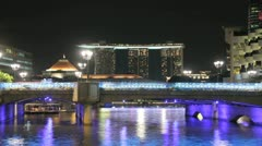 Night view from Clarke Quay of the Marina Bay Sands hotel in Singapore Stock Footage