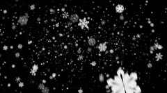 Snow flakes falling over black background in HD Stock Footage