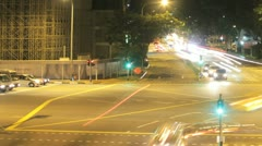 Panning time lapse of a busy traffic junction in Singapore Stock Footage