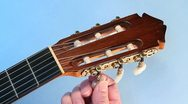 Classical guitar tuning  blue screen Stock Footage