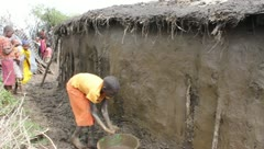 Masai Girl Plastering Hut  (HD) Stock Footage