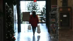 Stock Video Footage of Men and Women Shopping at the mall for Christmas or Birthday 26