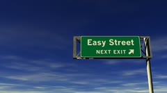 Stock Video Footage of easy street - freeway exit sign
