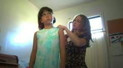 Mother Helping Daughter Get Ready For School or Church 2 Stock Footage