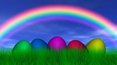 easter eggs under a rainbow - stock footage
