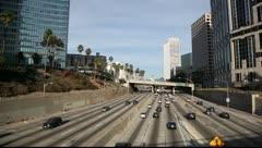 Sunday traffic on Freeway - Downtown LA - stock footage