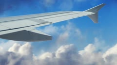Jet wing flying through the clouds Stock Footage