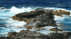 Rocky coast and tropical waters Stock Footage