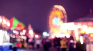 Stock Video Footage of carnival rides and games at night
