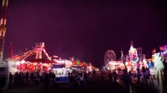 Carnival rides and games at night Stock Footage
