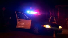 police car with lights flashing at roadblock - stock footage